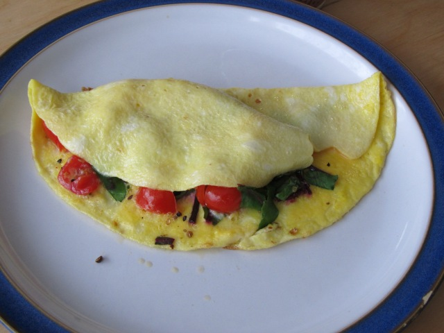 swiss chard, tomato and feta cheese omlet