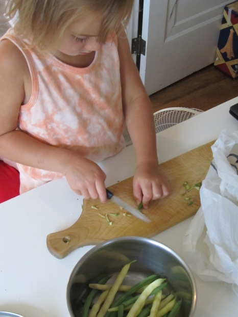 child chopping vegetables